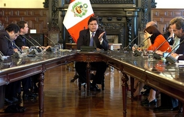 Peru's President Alan Garcia speaks during a press conference with foreign reporters at the presidential palace in Lima, Tuesday, Dec. 19, 2006.